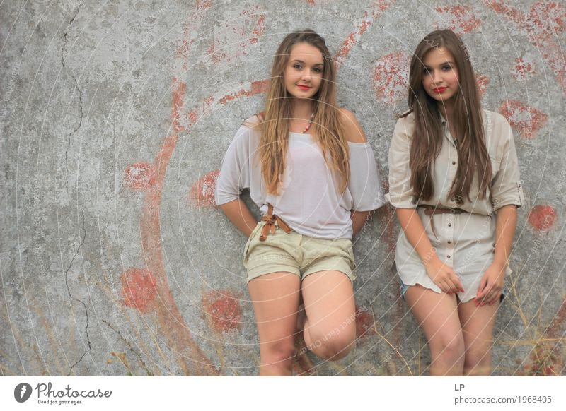 2 girls standing against a wall, posing for the camera Human being Woman Vacation & Travel Youth (Young adults) Young woman Beautiful Relaxation Calm Adults