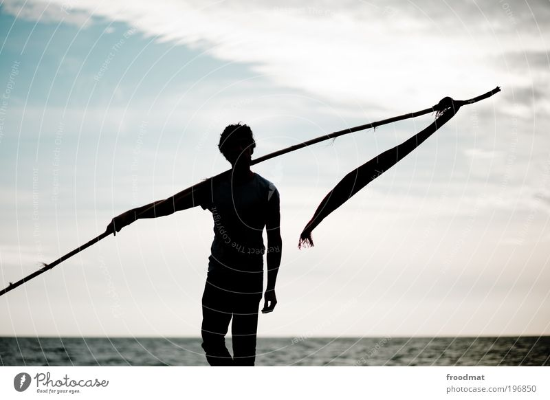 Human being Man Adults Dark Coast Power Walking Hiking Masculine Success Cool (slang) Change Might Threat Flag Brave