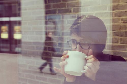 #A# coffee to go Feminine Esthetic Café Coffee To have a coffee Coffee cup Coffee break Looking Shows Eyeglasses Reflection Slice Window pane Glass Modern