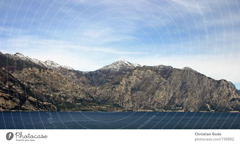 The mountain screams Nature Mountain Lake Lake Garda Vantage point Water Italy Sky Blue sky Stone Vacation & Travel aerial perspective Coast Lakeside Horizon