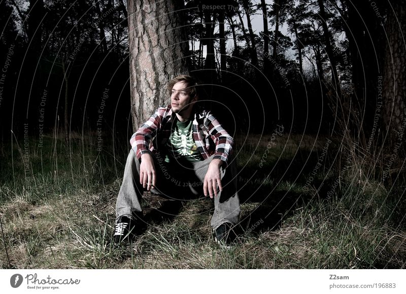 nature boy Human being Masculine Young man Youth (Young adults) Environment Nature Landscape Forest Shirt Jeans Blonde Relaxation Sit Dream Sadness Dark Creepy