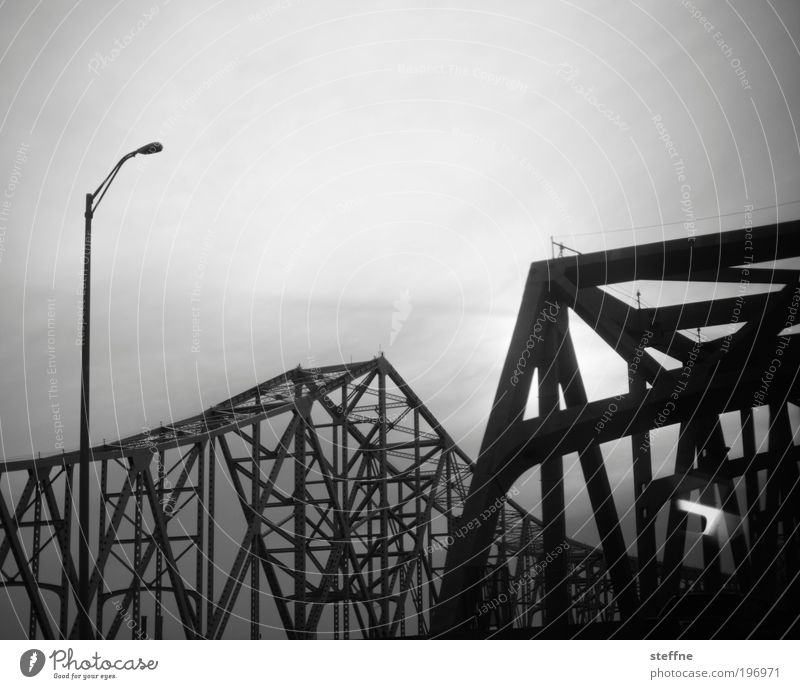 symphony in steel minor New Orleans USA Transport Bridge Dark Steel Steel construction Steel bridge Lantern Apocalyptic sentiment Black & white photo
