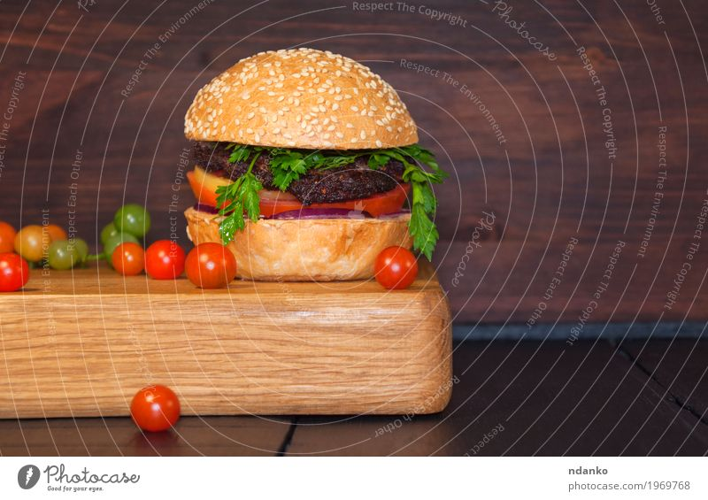 Meat sandwich sesame bun on a kitchen board Food Vegetable Bread Roll Nutrition Dinner Fast food Table Restaurant Eating Fresh Delicious Brown Red Black