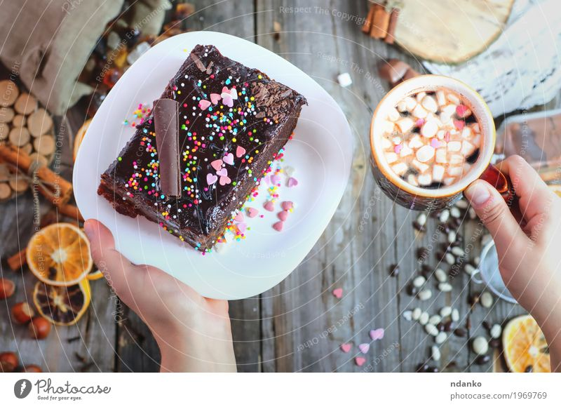 cup of coffee and a plate of cake Sacher in female hands Human being Woman Youth (Young adults) White Hand Red 18 - 30 years Adults Eating Wood Food Gray Brown Above Fruit Decoration