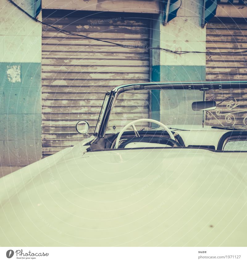 starboard Trip City trip Culture Capital city Old town Facade Means of transport Car Taxi Vintage car Convertible Retro Gloomy White Past Transience Time
