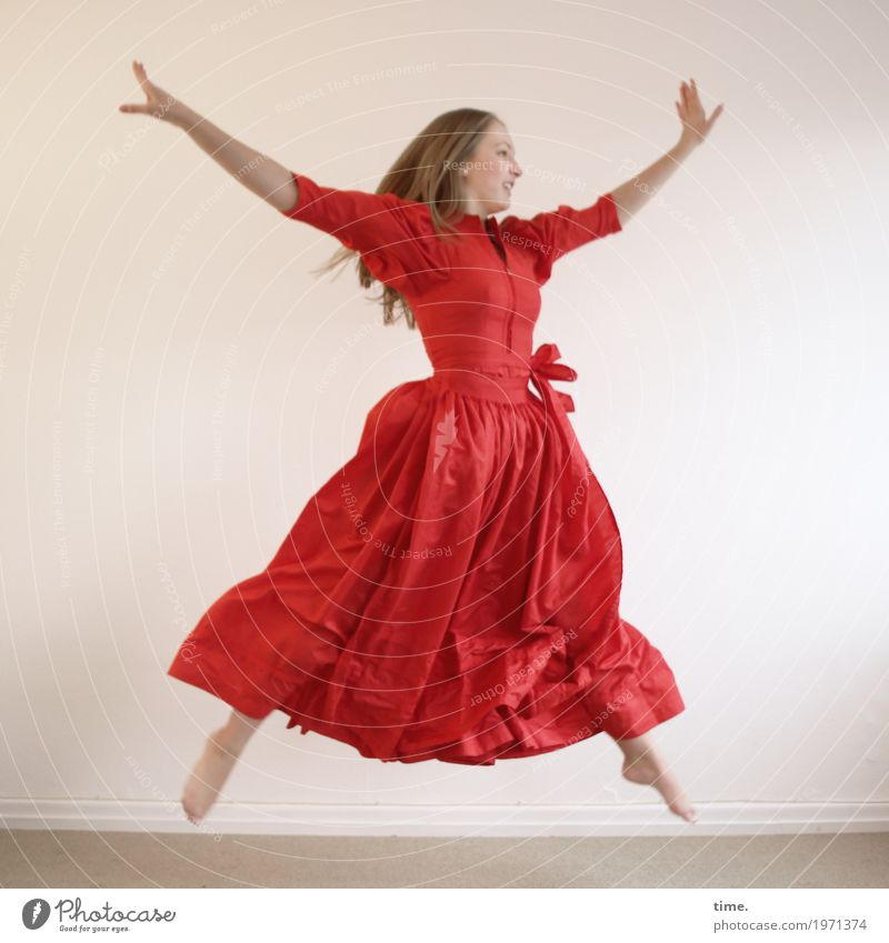 . Room Feminine Young woman Youth (Young adults) 1 Human being Dress Blonde Long-haired Movement Jump Dance Athletic Happiness Beautiful Red Joy