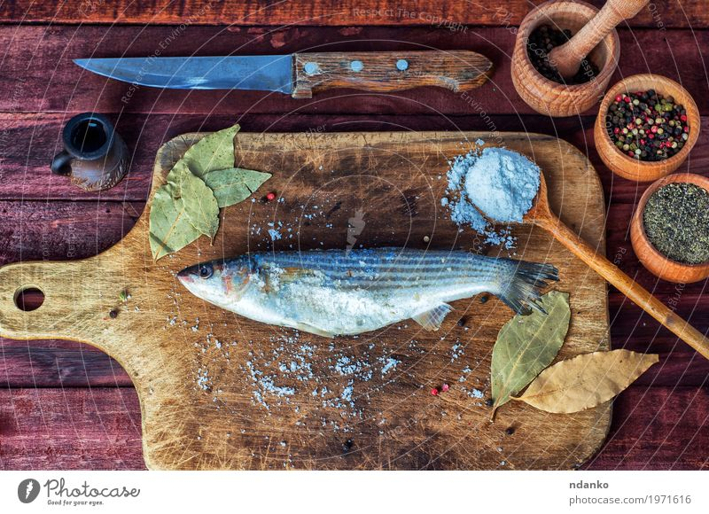 Fresh fish smelt for cooking on a kitchen board Nature White Eating Natural Wood Food Brown Above Metal Nutrition Fresh Table Fish Fish Herbs and spices Kitchen