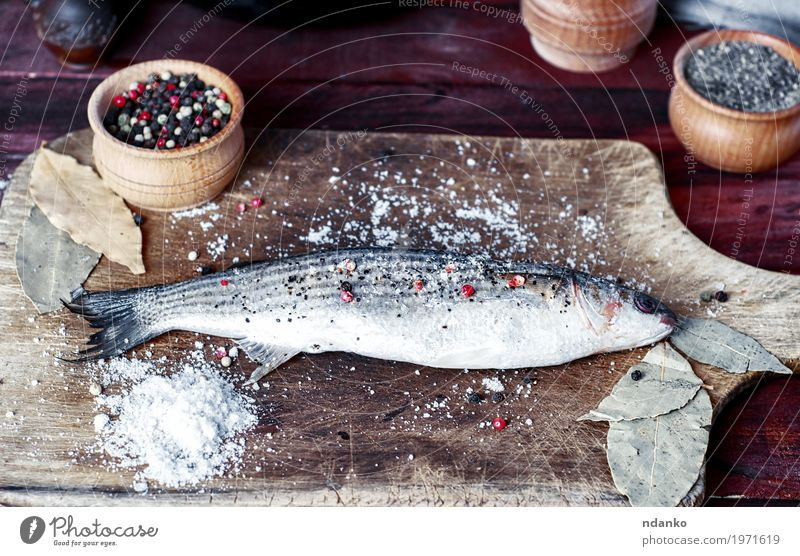 Live fish smelt on a kitchen board with spices Food Fish Herbs and spices Eating Bowl Spoon Table Kitchen Cook Wood Diet Fresh Natural Above Brown White pepper