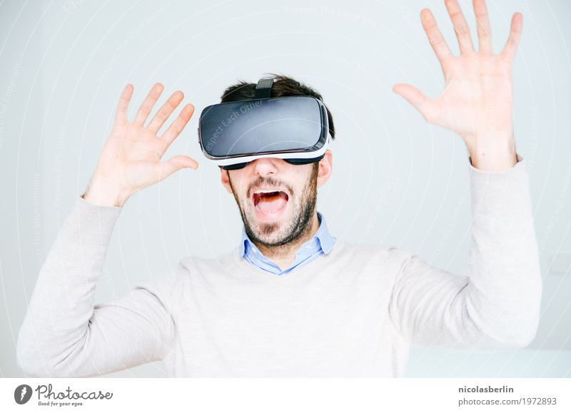 Man with VR glasses scared and raises his hands Joy Virtual virtual reality Science & Research Media industry Advertising Industry Telecommunications