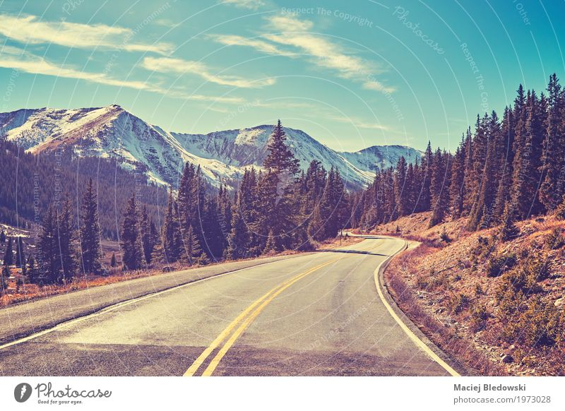 Retro color toned Rocky Mountains road. Vacation & Travel Trip Adventure Freedom Sightseeing Landscape Street Lanes & trails Highway Driving forward Destination