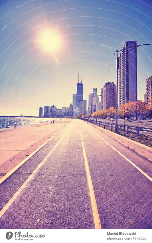 Chicago waterfront against sun Vacation & Travel Sun Small Town Downtown Skyline High-rise Building Architecture Tourist Attraction Landmark Cycling Pedestrian