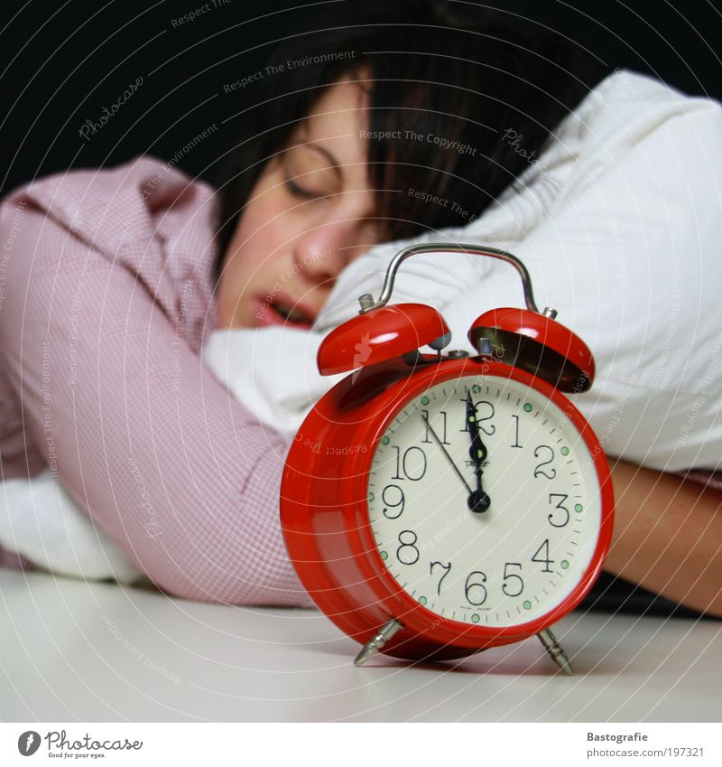 just before 12 Human being Sleep Alarm clock Arise Red Clock Bed Cushion Dream Clock hand Wake up Morning Morning grouchiness Oversleep be late Late Sheep