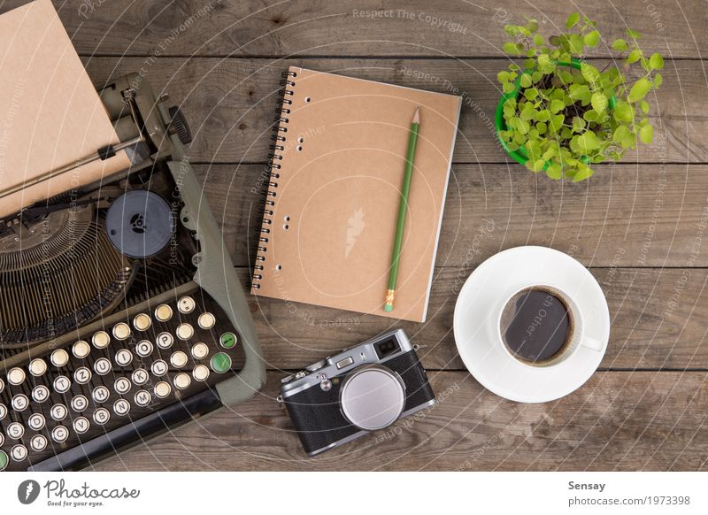 Vintage typewriter on the old wooden desk Coffee Tea Pot Design Desk Table Workplace Office Camera Newspaper Magazine Book Plant Paper Wood Old Write Retro