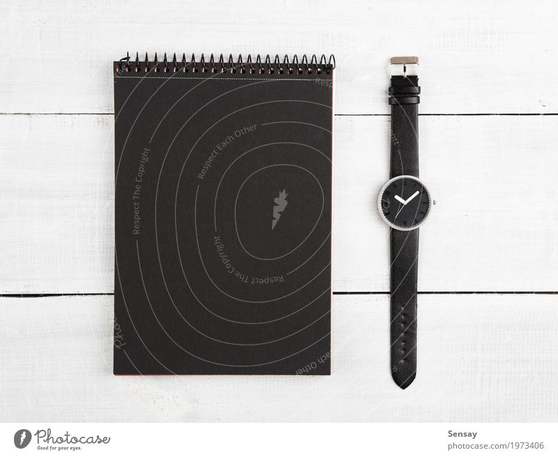 Notepad and watches on the desk Vacation & Travel Man Old White Black Adults Wood Business Tourism Design Work and employment Office Clock Modern Retro