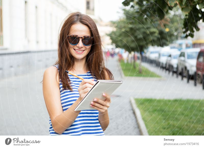 Girl with a notebook on the street Human being Woman Youth (Young adults) Summer Beautiful White Adults Street Happy Fashion Park Trip Sit Book Paper