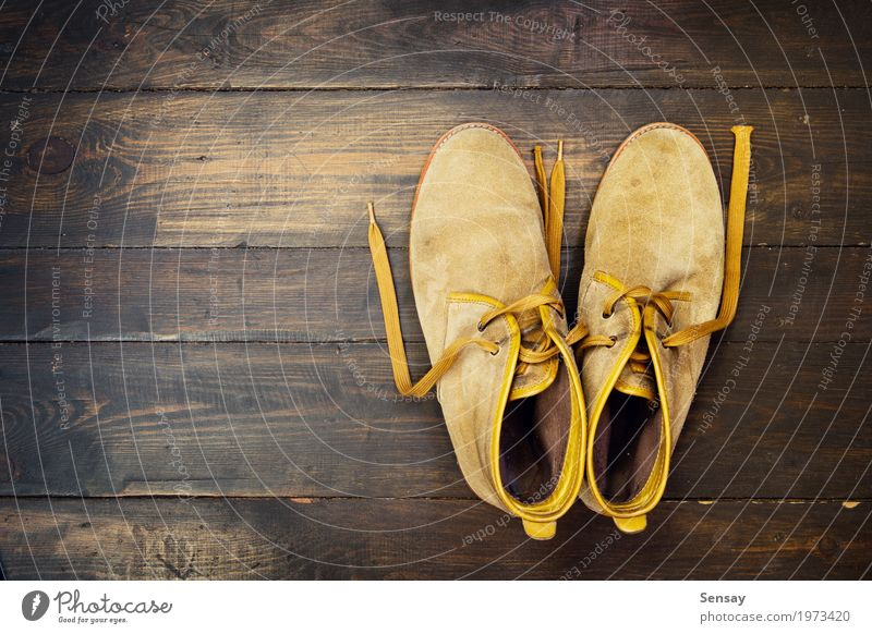 Desert shoes on the wooden backdrop Old Wood Fashion Brown Work and employment Footwear Tradition Boots Leather Consistency Grunge Hanging