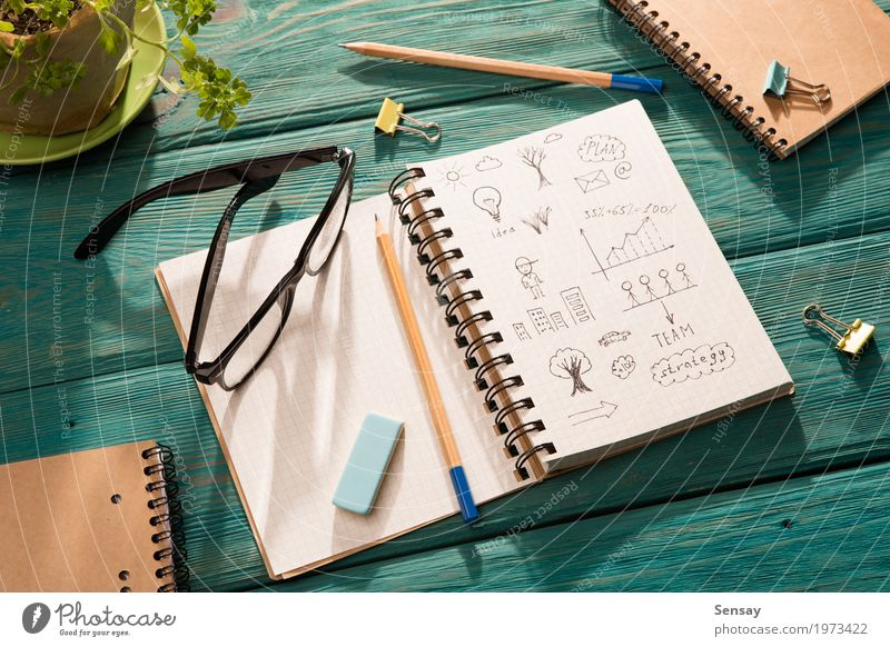 notepad with sketch on the desk under sunlight Desk Table Workplace Office Business Environment Tree Flower Paper Pen Wood Natural Blue Green Energy Idea