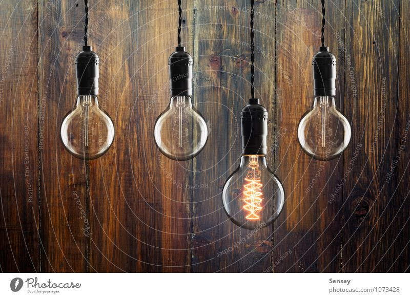 Idea and leadership concept Vintage incandescent bulbs Old Colour Red Yellow Wood Lamp Design Bright Technology Success Creativity Energy Symbols and metaphors