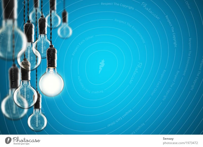 Idea and leadership concept bulbs on color wall Old Blue Colour Yellow Lamp Design Bright Technology Success Creativity Energy Symbols and metaphors