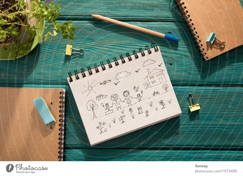 Happy family concept – sketch in the notebook Design Trip Sun House (Residential Structure) Desk Table Child School Workplace Mother Adults Father Sister
