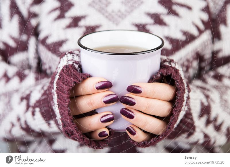 Woman in cozy sweater holding a cup Breakfast Beverage Coffee Tea Knit Winter Human being Girl Adults Hand Warmth Sweater Hot White Hold drink Seasons christmas