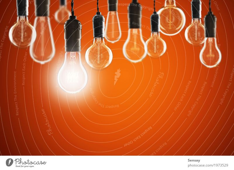 Idea and leadership concept - bulbs on the grunge background Design Lamp Success Science & Research Technology Old Bright Red Energy Creativity