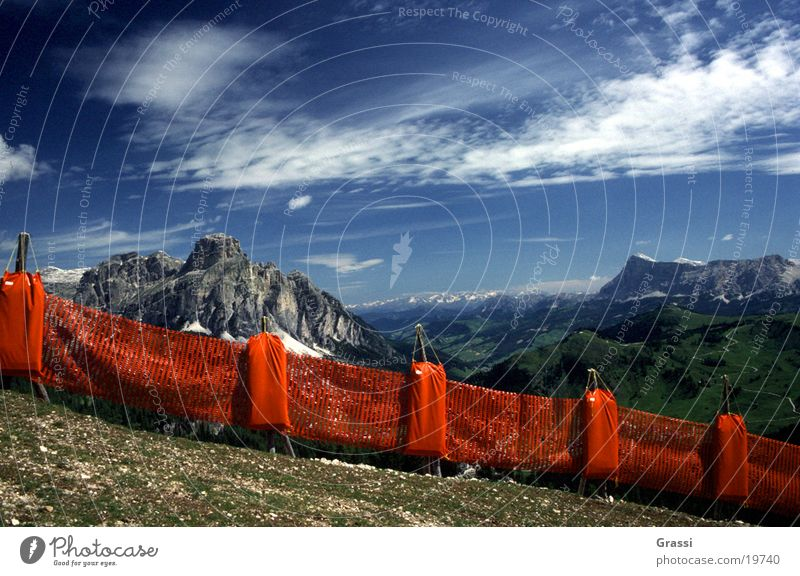 Dolomites Catch fence Ski run Mountain Clouds Track Ski lift Snow Weather Blue sky Air Pure Fence Border Boundary Protection Vantage point Landscape glaciers
