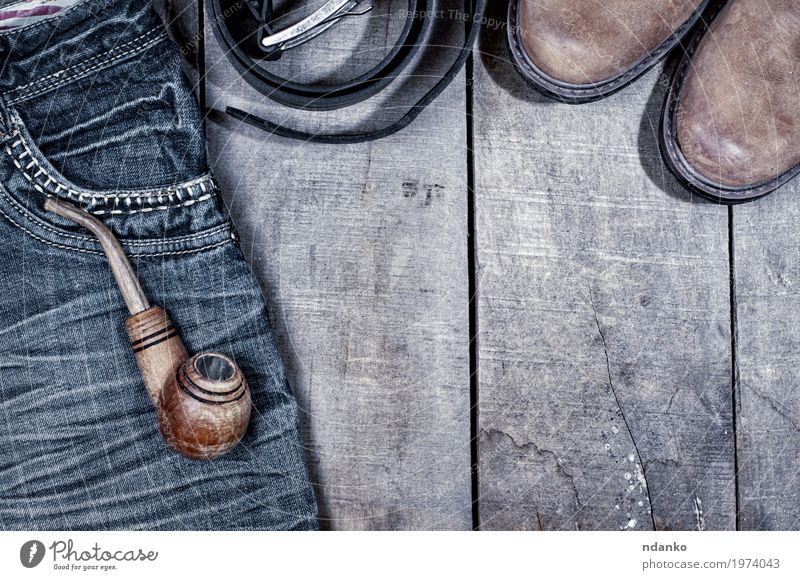 Wooden pipe for smoking on blue jeans Clothing Workwear Pants Jeans Leather Footwear Boots Old Above Retro Blue Gray Black tobacco wood everyday vintage worn