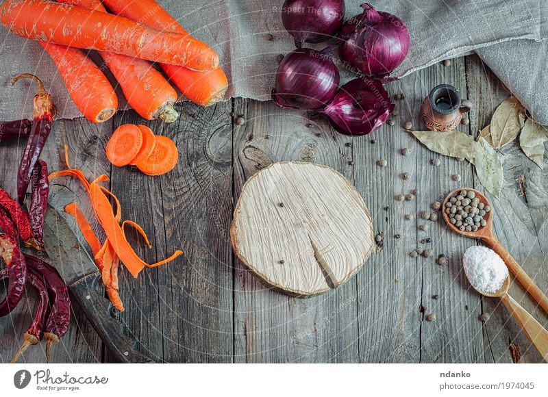Fresh carrots and onions on a gray wooden table Food Vegetable Herbs and spices Eating Breakfast Vegetarian diet Diet Juice Spoon Table Kitchen Wood Natural
