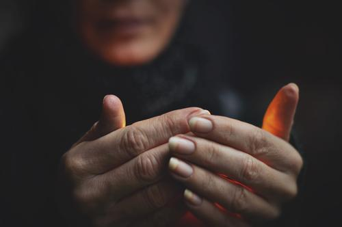 small light Woman Hand Fingers Illuminate Light Hidden Dark Warmth To hold on Concealed Candlelight