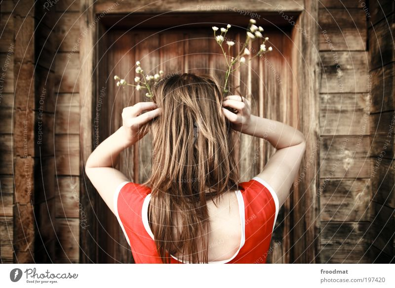 Woman Human being Youth (Young adults) Flower Adults Feminine Hair and hairstyles Style Door Mysterious Switzerland Whimsical Young woman Hip & trendy