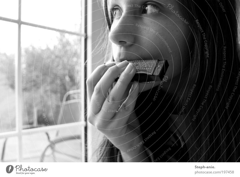 The harmonica. 1 Human being Music mouth organ Secrecy Dream Longing Loneliness Meditative Black & white photo