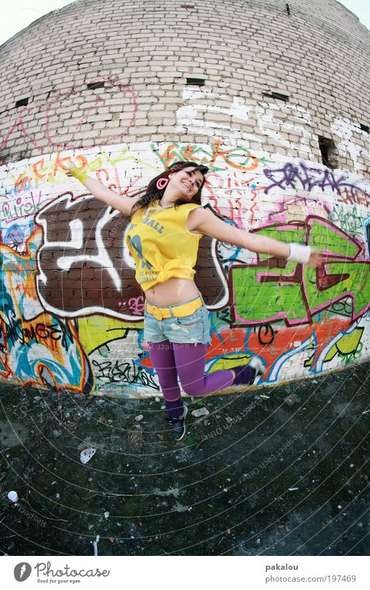Woman Youth (Young adults) Green City Joy Adults Yellow Feminine Wall (building) Graffiti Laughter Jump Wall (barrier) Fashion Dance Free