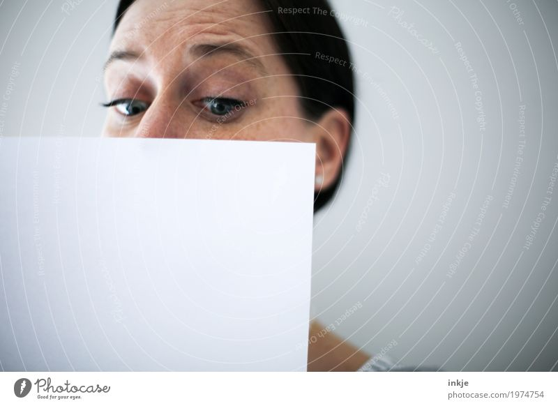 Woman face behind white sheet of paper Lifestyle Leisure and hobbies Education Adult Education Adults Face 1 Human being 30 - 45 years 45 - 60 years Paper