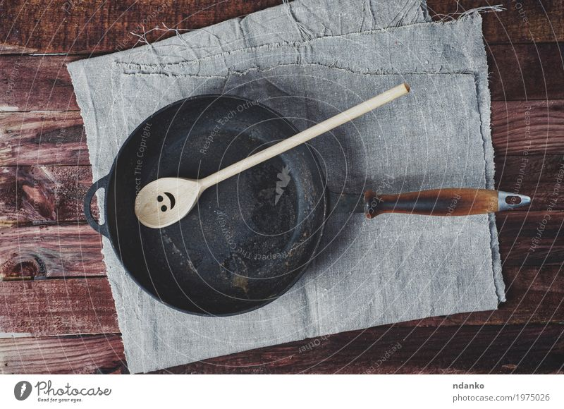 Frying pan frying pans and a wooden paddle Black Dish Wood Brown Above Metal Table Clean Kitchen Cloth Restaurant Crockery Top Tool Household Tablecloth