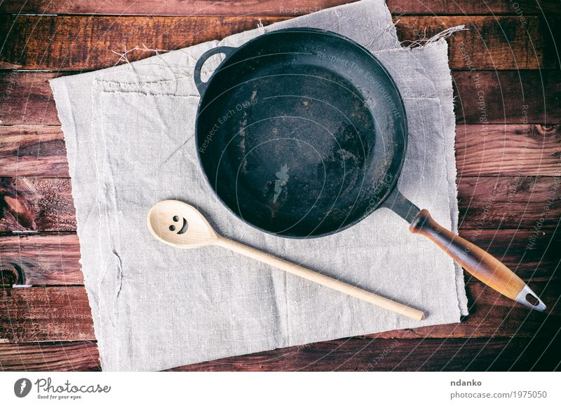 cast iron pan with a spatula on a gray textile napkin Black Dish Wood Brown Above Design Metal Table Clean Kitchen Cloth Restaurant Crockery Top Tool Household