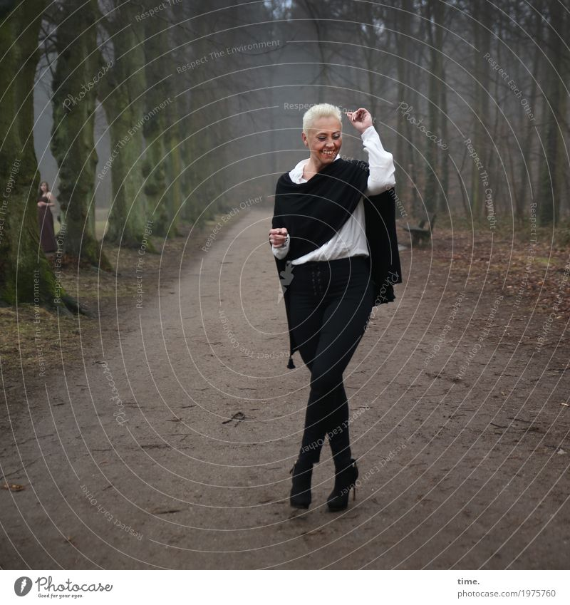 . Feminine 1 Human being 2 Winter Tree Forest Lanes & trails Shirt Pants Cloth High heels Blonde Short-haired Laughter Stand Dance Exceptional Positive