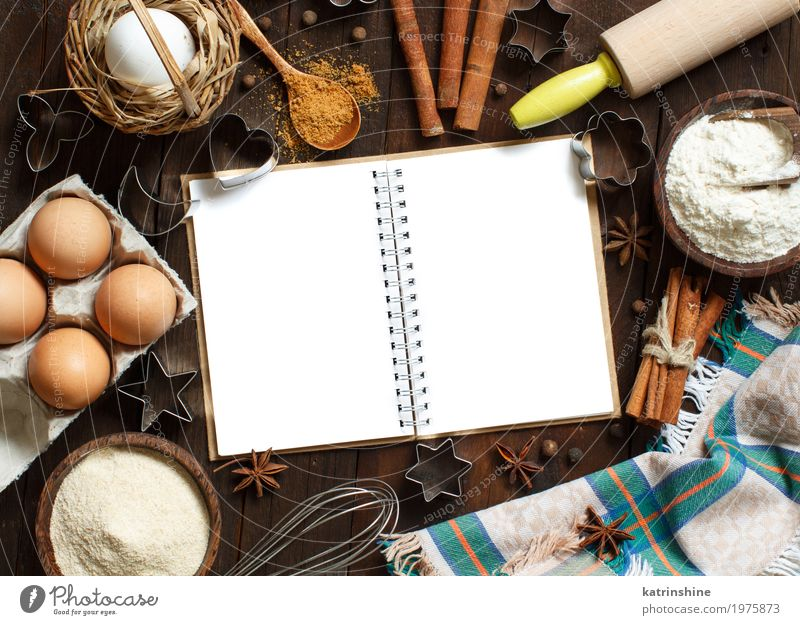 Blank cooking book, ingredients and utensils top view Food Dairy Products Grain Dough Baked goods Bread Dessert Herbs and spices Bowl Table Kitchen Paper Wood
