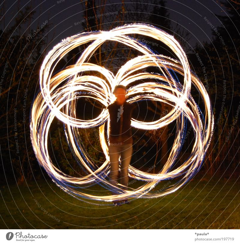 fishing pole Joy Happy Playing 1 Human being Art Artist Elements Fire Movement Illuminate Stand Esthetic Exceptional Dark Hot Speed Yellow Gold Black