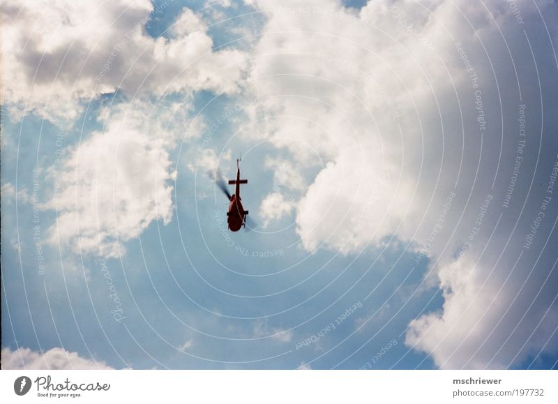Helicopter in the cloudy sky Clouds Sunlight Aviation Rescue helicopter Speed Blue Colour photo Exterior shot Day Light Contrast Silhouette Wide angle
