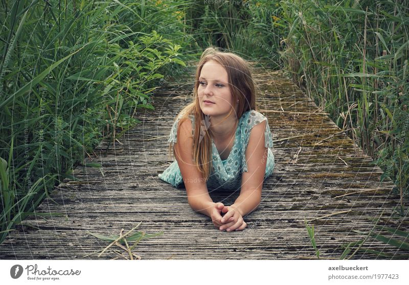 young woman lies on wooden walkway Lifestyle Leisure and hobbies Human being Feminine Young woman Youth (Young adults) Woman Adults 1 18 - 30 years Nature Grass