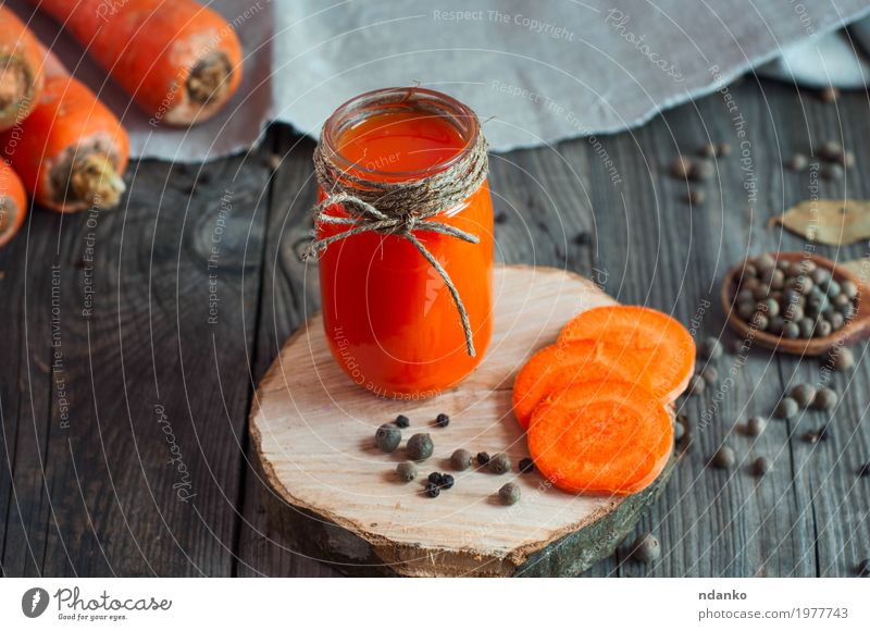 carrot juice with a glass jar on a wooden surface Natural Gray Above Orange Fresh Glass Table Herbs and spices Beverage Drinking Vegetable Bottle Top Slice Vegetarian diet Diet