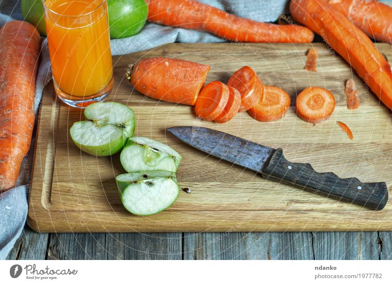 Carrot and apple juice at home Vegetable Apple Nutrition Eating Breakfast Vegetarian diet Diet Beverage Cold drink Juice Knives Table Nature Wood Fresh Natural