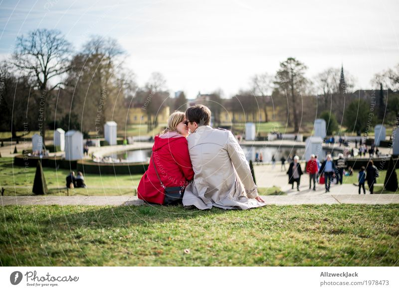 Kissing in the park Harmonious Well-being Contentment Relaxation Calm Trip Sightseeing City trip Sunbathing Masculine Feminine Young woman Youth (Young adults)
