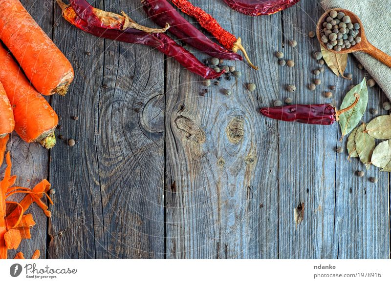 Gray wooden background with raw vegetables and spices Old Red Eating Wood Food Above Orange Nutrition Fresh Table Herbs and spices Vegetable Top Vegetarian diet