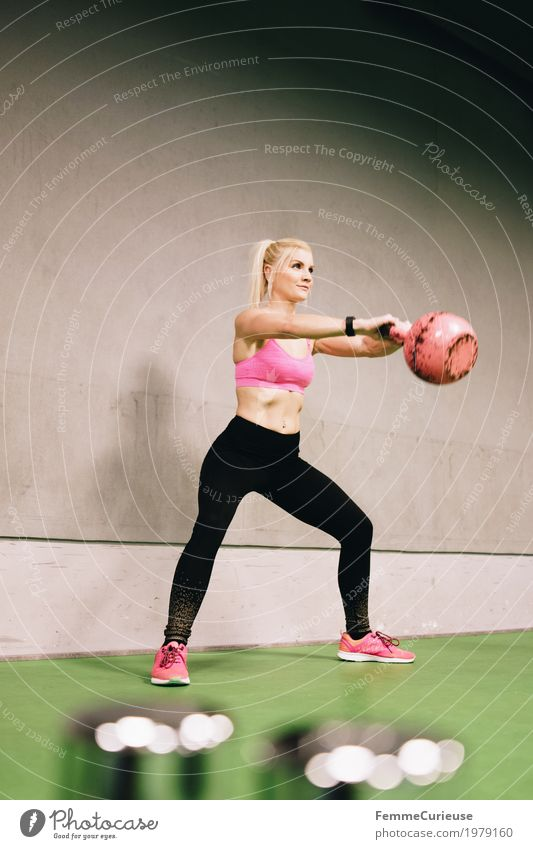 Fitness_34_1979160 Lifestyle Feminine Young woman Youth (Young adults) Woman Adults Human being 18 - 30 years Movement kettlebell Pink Concrete wall Healthy