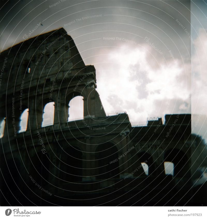 colosseo Sky Clouds Storm clouds Weather Bad weather Rome Italy Europe Capital city Ruin Manmade structures Architecture Tourist Attraction Colosseum Gray Black