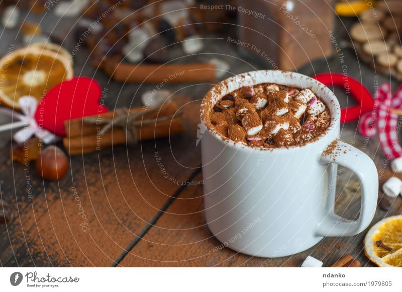 Drink with marshmallows and sprinkled with cocoa powder Red Winter Eating Wood Gray Brown Above Heart Herbs and spices Beverage Drinking Delicious Candy Hot