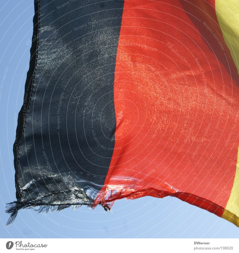 Red Black Germany Gold Signs and labeling Broken Stripe Flag Shabby Hang Section of image Partially visible Abrasion Torn Republic