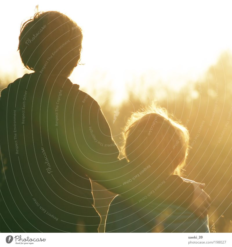 Family & Relations Love Boy (child) Emotions Child Happy Moody Safety Human being Stand Protection Trust Joie de vivre (Vitality) Touch Infancy Sunset